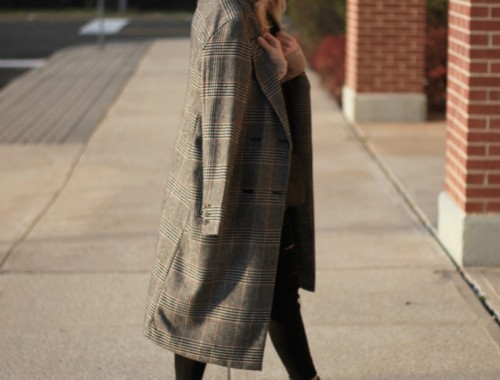 the trendy way to wear a coat